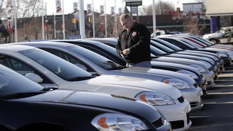 A potential customer looks at a 2009 Chevrolet Impala sedan at a car dealership in Dearborn, Michigan