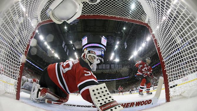 New Jersey Devils goalie Martin Brodeur (30) watches the puck as he defends the goal during the second period of Game 2 of the NHL hockey Stanley Cup against the Los Angeles Kings, Saturday, June 2, 2012, in Newark N.J. (AP Photo/Bruce Bennett, Pool)