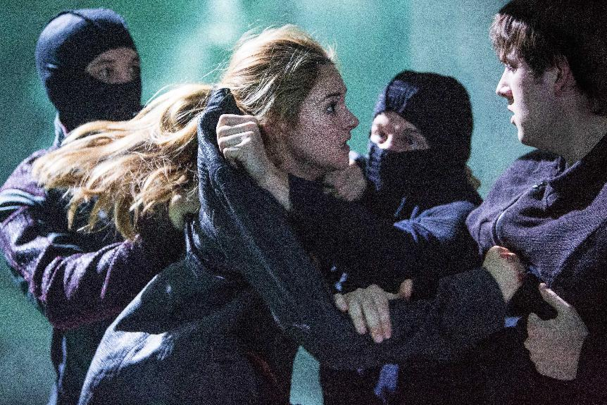 "This publicity photo released by Summit Entertainment shows Shailene Woodley, left, and Christian Madsen in a scene from the film, ""Divergent."" (AP Photo/Summit Entertainment, Jaap Buitendijk)"