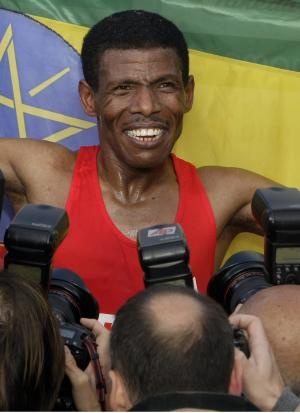 FILE - In this Sunday, Sept. 30, 2007 file photo Ethiopian runner Haile Gebrselassie smiles while posing for the media after winning the men's competition of the 34th Berlin Marathon. Gebrselassie set a new world record time by clocking 2 hours, 4 minutes and 26 seconds. For two decades, Haile Gebrselassie has delighted fans of running, with his mastery of and dedication to his art but his ambitions of competing at a fifth Olympic Games are slipping away. (AP Photo/Franka Bruns, file)