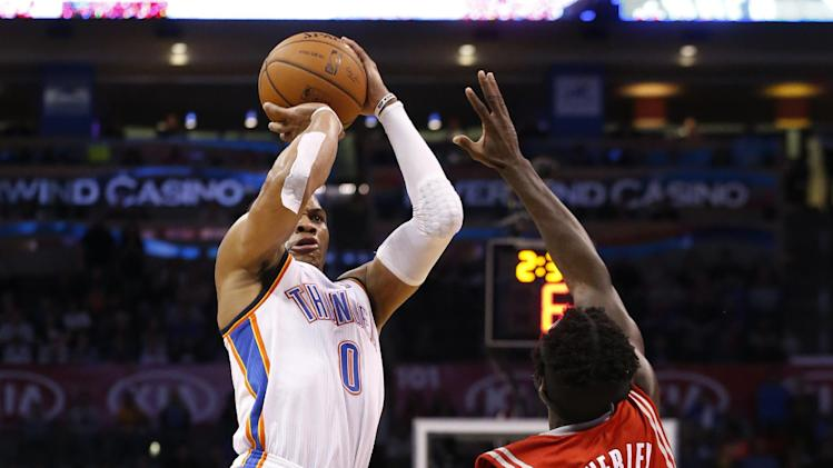Oklahoma City Thunder guard Russell Westbrook (0) shoots over Houston Rockets guard Pat Beverley (2) during the fourth quarter of an NBA basketball game in Oklahoma City, Tuesday, March 11, 2014. Oklahoma City won 106-98. (AP Photo/Sue Ogrocki)