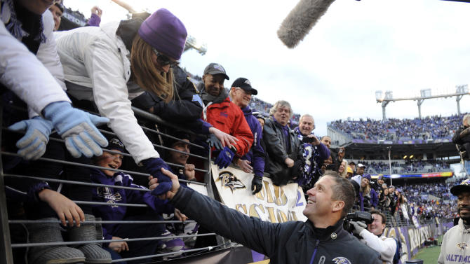 Baltimore Ravens head coach John Harbaugh greets fans after an NFL wild card playoff football game against the Indianapolis Colts Sunday, Jan. 6, 2013, in Baltimore. The Ravens won 24-9. (AP Photo/Nick Wass)