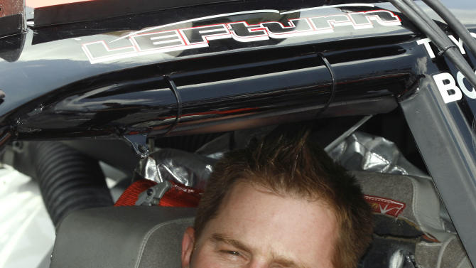 FILE - In this July 6, 2007 file photo, NASCAR Busch series driver Jason Leffler sits in his car before his qualifying run at the Daytona International Speedway in Daytona Beach, Fla. Leffler died after an accident in a heat race at a dirt car event at Bridgeport Speedway in Swedesboro, N.J., Wednesday night, June 12, 2013, New Jersey State Police said. (AP Photo/Glenn Smith, File)