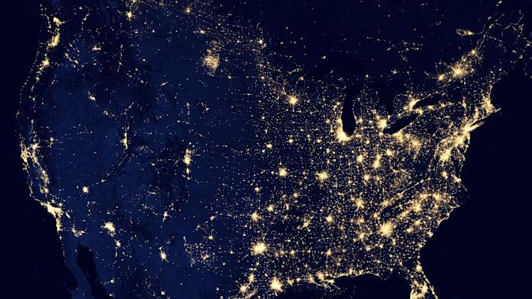 """This NASA image from a composite assembled from data acquired by the Suomi NPP satellite in April and October 2012 shows the United States at night The image was made possible by the new satellite's """"day-night band"""" of the Visible Infrared Imaging Radiometer Suite (VIIRS), which detects light in a range of wavelengths from green to near-infrared and uses filtering techniques to observe dim signals such as city lights, gas flares, auroras, wildfires, and reflected moonlight. (AP Photo/NASA)"""
