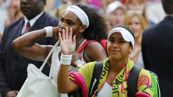 Heather Watson of Britain applauds the fans after losing her match to Serena Williams of the U.S.A. (L) at the Wimbledon Tennis Championships in London