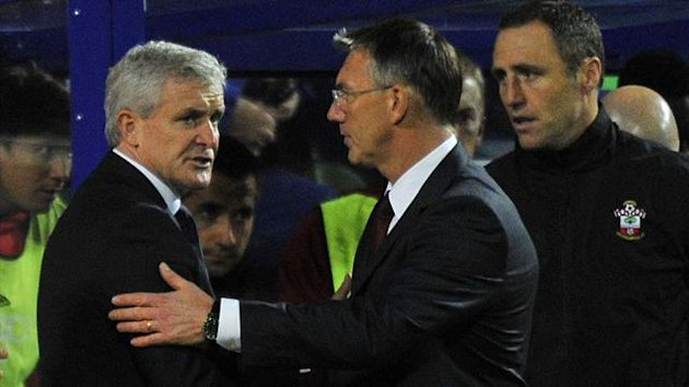 Queens Park Rangers' manager Mark Hughes (L) shakes hands with Southampton manager Nigel Adkins (Reuters)
