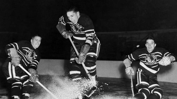"""FILE- In this Dec. 3, 1942, file photo, the all-brother line of the Chicago Blackhawks, from left, Reggie Bentley, Max Bentley and Doug Bentley, skate for a photo in Chicago. The NHL has the best names in the business. Nicknames, that is. Little Ball of Hate. The Great One. Tazer. Bicksy. Max Bentley was known as the """"Dipsy Doodle Dandy from Delisle"""" (AP Photo/File)"""