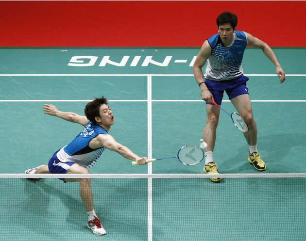 South Korea's Ko and Lee play a shot during their men's doubles match against Thailand's Maneepong and Nipitphon at the semi-finals of the Sudirman Cup World Team Badminton Championships in Kuala Lump