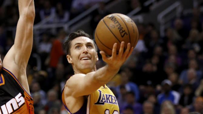 Los Angeles Lakers' Steve Nash (10) shoots against the Phoenix Suns during the first half of an NBA basketball game, Wednesday, Jan. 30, 2013, in Phoenix. (AP Photo/Matt York)