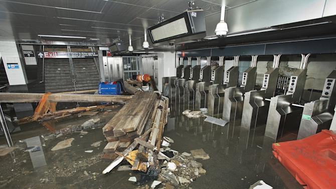 FILE- In this Oct. 30 2012 file photo provided by the Metropolitan Transportation Authority, the South Ferry subway station in New York City is filled with seawater and debris from Superstorm Sandy. More than three decades before Sandy, a state law and a series of legislative reports began warning New York politicians to prepare for a storm of historic proportions, spelling out scenarios eerily similar to what actually happened. (AP Photo/ Metropolitan Transportation Authority, File)