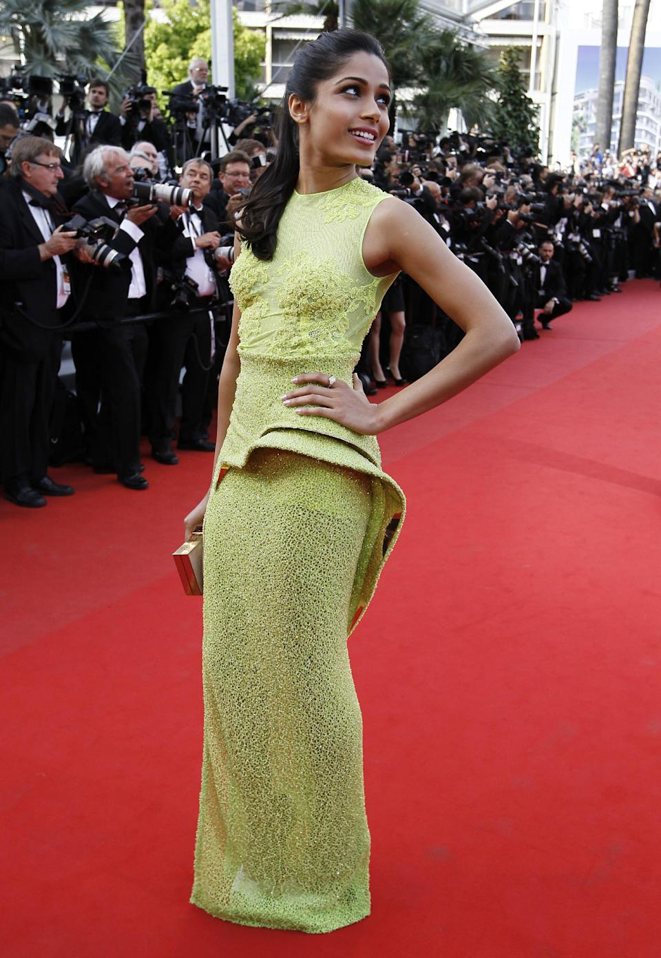 Actress Freida Pinto arrives for the screening of Rust and Bone at the 65th international film festival, in Cannes, southern France, Thursday, May 17, 2012.  Pinto is wearing Atelier Versace.(AP Photo/Francois Mori)
