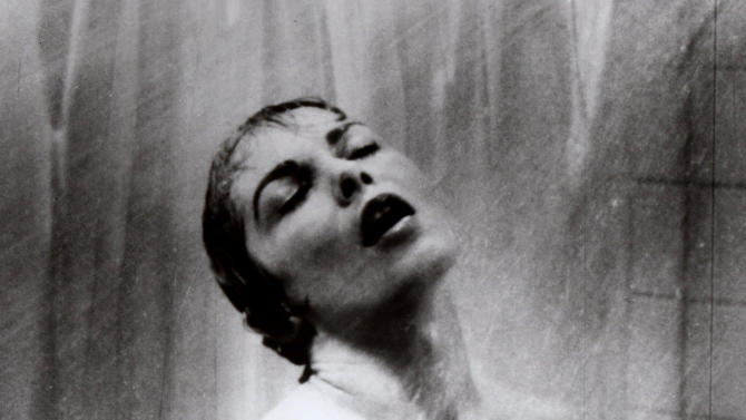 """FILE - In this 1960 file photo, actress Janet Leigh appears as Marion Crane in the shower scene in Alfred Hitchcock's 1960 classic thriller """"Psycho."""" Hitchcock's """"Psycho"""" is a film that 52 years after its shocking premiere still hasn't released audiences from its subversive thrall. The film, which Hitchcock called """"a fun picture,"""" was revolutionary in its violence, its sexiness, its sympathy to the perspective of the criminal mind, and, perhaps above all, its technique. (AP Photo/File)"""