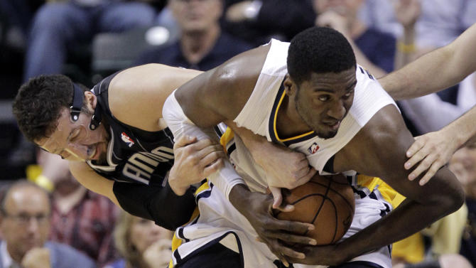 Orlando Magic forward Hedo Turkoglu, left, and Indiana Pacers center Roy Hibbert tussle for control of the ball in the first half of Game 5 of an NBA basketball first-round playoff series, in Indianapolis on Tuesday, May 8, 2012. (AP Photo/Michael Conroy)