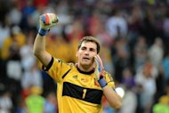 Spanish goalkeeper Iker Casillas celebrates at the end of the penalty shoot out of the Euro 2012 football championships semi-final match Portugal vs. Spain at the Donbass Arena in Donetsk. Defending champions Spain beat Portugal 4-2 on penalties after their Euro 2012 semi-final finished 0-0 after extra-time here on Wednesday