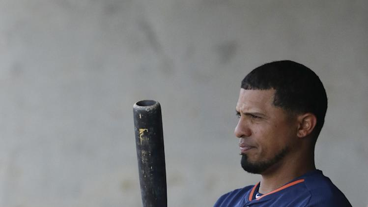 Houston Astros' Cesar Izturis is seen in the dugout during a spring exhibition baseball game against the Washington Nationals in Kissimmee, Fla., Sunday, March 16, 2014. (AP Photo/Carlos Osorio)