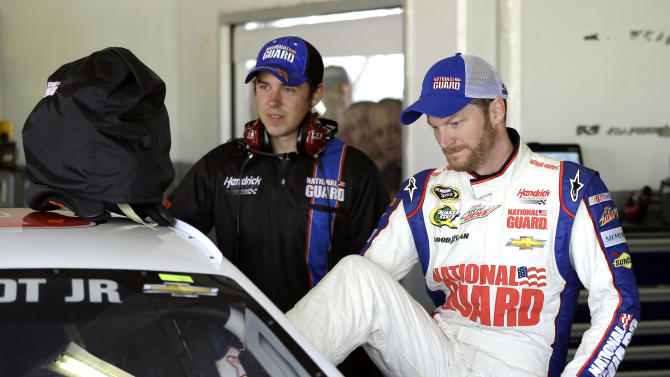 Dale Earnhardt Jr., right, climbs into his car during a practice session for the NASCAR Sprint Cup Series Daytona 500 auto race Friday, Feb. 22, 2013, at the Daytona International Speedway in Daytona Beach, Fla. (AP Photo/Chris O'Meara)