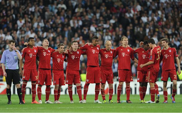 Members Of The Bayern Munich Squad Wait For The Start Of The Penalty Shoot Out AFP/Getty Images
