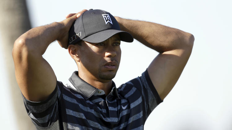 Tiger Woods waits to tee off on the ninth hole during the first round of the Cadillac Championship golf tournament, Thursday, March 7, 2013 in Doral, Fla. (AP Photo/Wilfredo Lee)