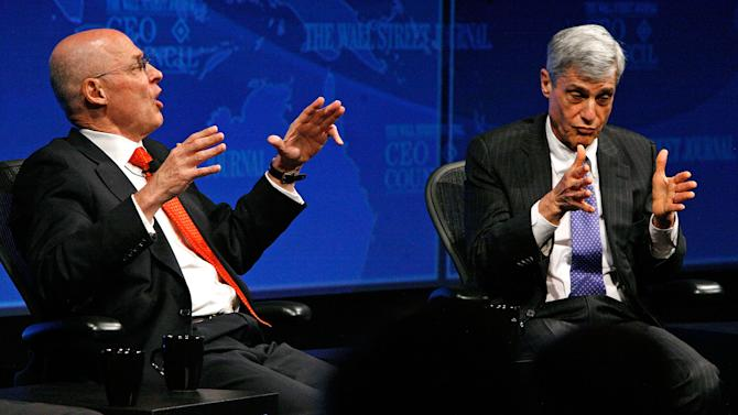 Former US Treasury Secretaries Henry Paulson (L) and Robert Rubin participate in a panel discussion on November 17, 2008 in Washington