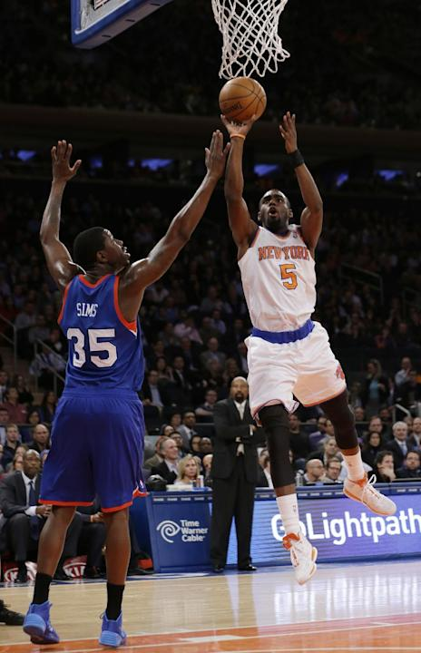 New York Knicks' Tim Hardaway Jr. (5) shoots over Philadelphia 76ers' Henry Sims (35) during the first half of an NBA basketball game Monday, March 10, 2014, in New York