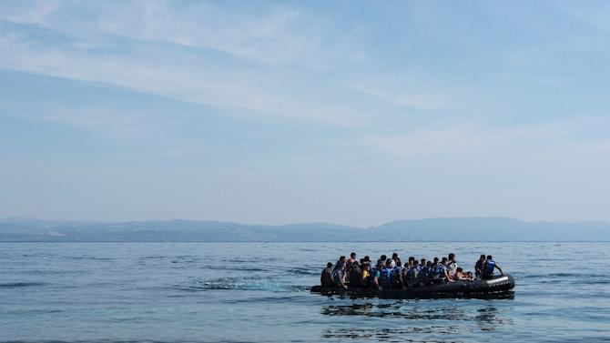 Refugees from Afghanistan arrive in a boat on the shores of Lesbos near Skala Skamnias, Greece on June 2, 2015