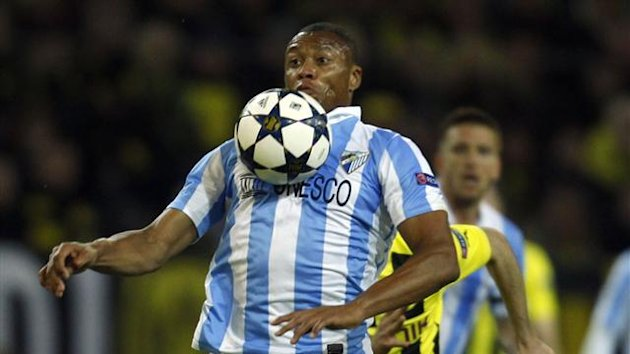 Malaga's Julio Baptista controls the ball during the Champions League quarter-final second leg match against Borussia Dortmund (Reuters)