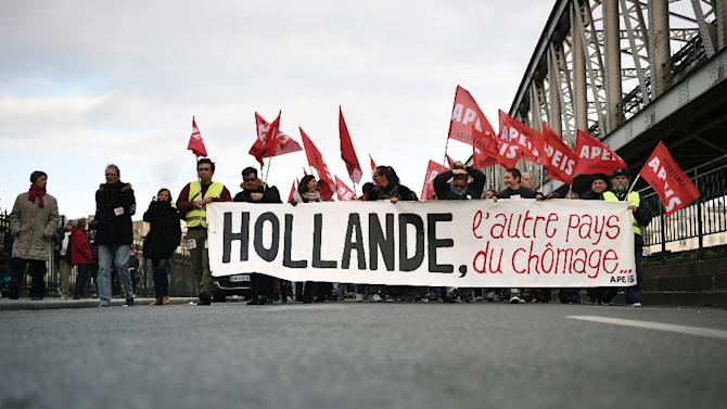 People demonstrate on December 6, 2014 in the streets of Paris against unemployment