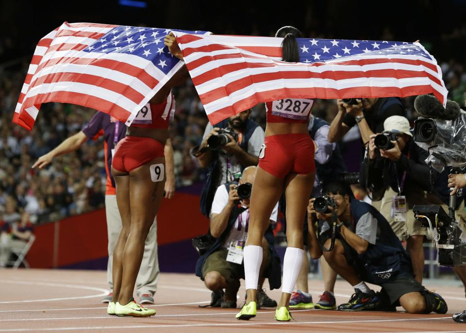United States' Allyson Felix, right, and United States' Carmelita Jeter pose for photographers following the women's 200-meter final during the athletics in the Olympic Stadium at the 2012 Summer Olympics, London, Wednesday, Aug. 8, 2012. Felix won gold and Jeter won silver. (AP Photo/Lee Jin-man)