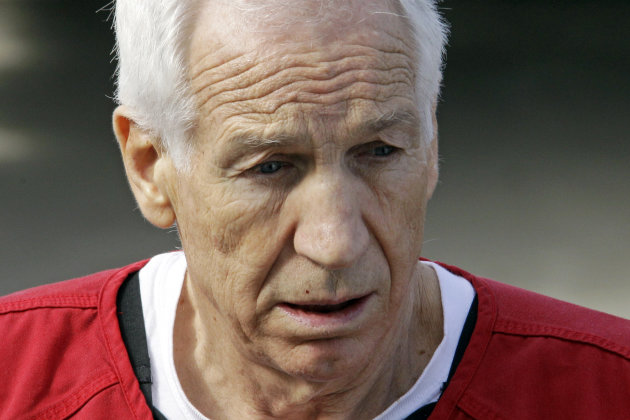 Former Penn State University assistant football coach Jerry Sandusky, center, leaves the Centre County Courthouse after being sentenced in Bellefonte, Pa., Tuesday, Oct. 9, 2012. Sandusky was sentenced Tuesday to at least 30 years in prison, effectively a life sentence, in the child sexual abuse scandal that brought shame to Penn State and led to coach Joe Paterno's downfall. (AP Photo/Gene J. Puskar)