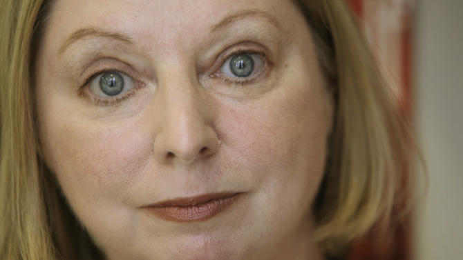 "FILE - The Booker Prize winning author Hilary Mantel poses for a photograph in London in this file photo dated Thursday, Oct. 8, 2009.  Mantel is widely criticized in the media Tuesday Feb. 19, 2013, for her ""venomous attack"" on the former Kate Middleton, the wife of Prince William, for published comments about the British public's complex relationship with royalty quoting Mantel saying the princess is ""a jointed doll on which certain rags were hung"", and said she appeared to be designed by committee with a perfect plastic smile. (AP Photo/Alastair Grant, File)"