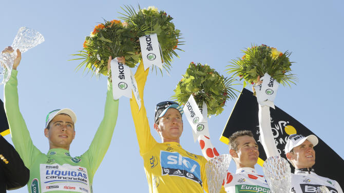 Tour de France winner Bradley Wiggins of Britain, second left, best climber Thomas Voeckler of France, second right, best sprinter Peter Sagan of Slovakia, left, and best young rider Tejay van Garderen of the US, right, celebrate on the podium of the the Tour de France cycling race in Paris, France, Sunday July 22, 2012. (AP Photo/Laurent Cipriani)