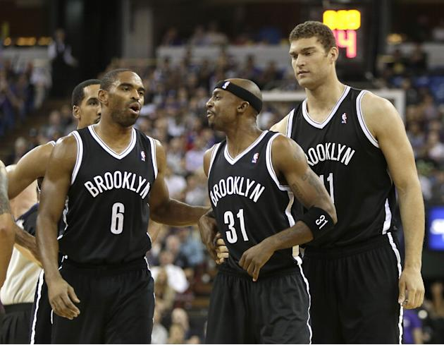 Brooklyn Nets guard Jason Terry, center, is restrained by teammates Alan Anderson, left, and Brooks Lopez, after exchanging heated words with Sacramento Kings guard Greivis Vasquez during the fourth q