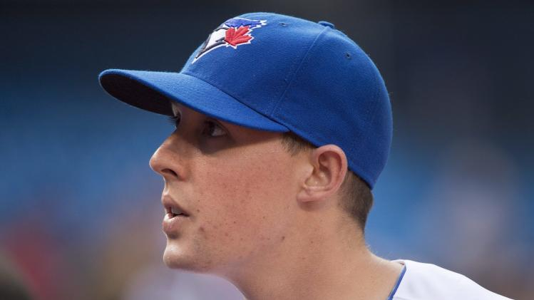 Toronto Blue Jays pitcher Aaron Sanchez looks on before his team takes on the Boston Red Sox before a baseball game, Tuesday, July 22, 2014 in Toronto. (AP Photo/The Canadian Press, Nathan Denette)