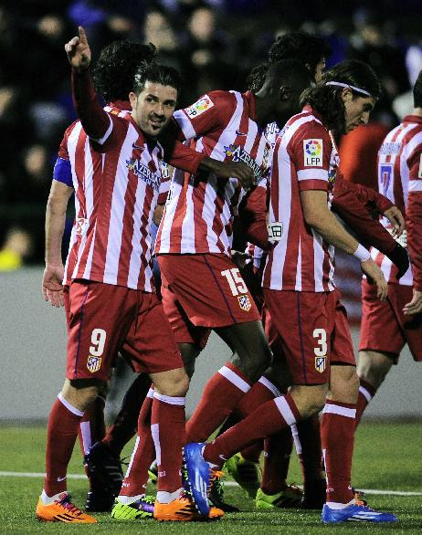 Atletico Madrid's David Villa, left, celebrates scoring against Sant Andreu during a Copa del Rey soccer match at the Municipal Narcis Sala stadium in Barcelona, Spain, Saturday, Dec. 7, 2013