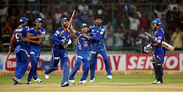 Mumbai Indians players celebrate after wining the final match between Rajasthan Royals and Mumbai Indians at Feroz Shah Kotla stadium, in Delhi on Oct. 6, 2013. (Photo: IANS)