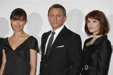 "Actress Arterton who plays Agent Fields, actor Craig who plays ""James Bond"" and actress Kurylenko who plays ""Camille"" pose during a photocall at Pinewood Studios north of London"