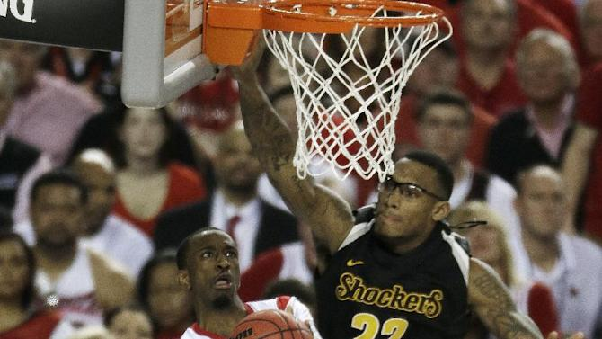 Louisville's Russ Smith (2) shoots against Wichita State's Carl Hall (22) during the second half of the NCAA Final Four tournament college basketball semifinal game Saturday, April 6, 2013, in Atlanta. (AP Photo/Chris O'Meara)