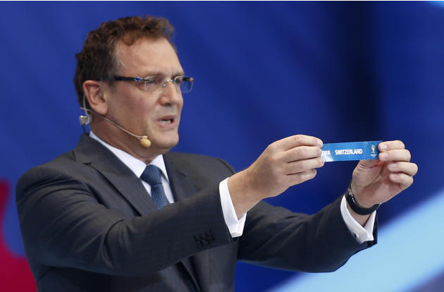 FIFA Secretary General Jerome Valcke holds the ticket of Switzerland during the draw ceremony for the 2014 soccer World Cup in Costa do Sauipe near Salvador, Brazil, Friday, Dec. 6, 2013