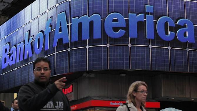 People walk next to a Bank of America's branch in New York