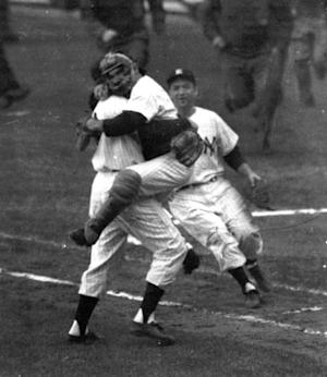 FILE- In this Oct. 8, 1956, file photo, New York Yankees catcher Yogi Berra is embraced by pitcher Don Larsen as he leaps into Larsen's arms at the end of Game 5 of baseball's World Series against the Brooklyn Dodgers at New York's Yankee Stadium. Larsen pitched a perfect game. The jersey worn by Larsen when he pitched the only perfect game in World Series history will soon be available for auction by Steiner Sports Memorabilia who will run the auction October through December 2012. (AP Photo, File)