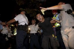 A pro-democracy activist is detained by the police during a confrontation in Hong Kong