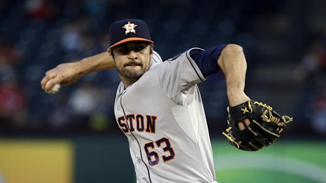 Houston Astros starting pitcher Nick Tropeano works against the Texas Rangers in the first inning of a baseball game, Monday, Sept. 22, 2014, in Arlington, Texas. (AP Photo/Tony Gutierrez)
