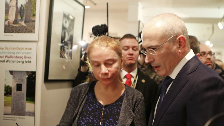 Freed Russian former oil tycoon Khodorkovsky listens to Hildebrandt, director of Museum Haus am Checkpoint Charlie, as he visits the museum in Berlin