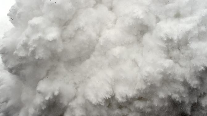 A cloud of snow and debris triggered by an earthquake roars towards Everest Base Camp, moments ahead of flattening part of the camp in the Himalayas, on April 25, 2015