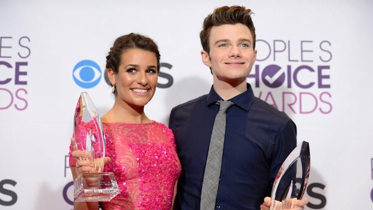 Lea Michele, left, winner of the award for favorite comedic TV actress, and Chris Colfer, winner of the award for favorite comedic TV actor, pose backstage at the People's Choice Awards at the Nokia Theatre on Wednesday Jan. 9, 2013, in Los Angeles. (Photo by Jordan Strauss/Invision/AP)