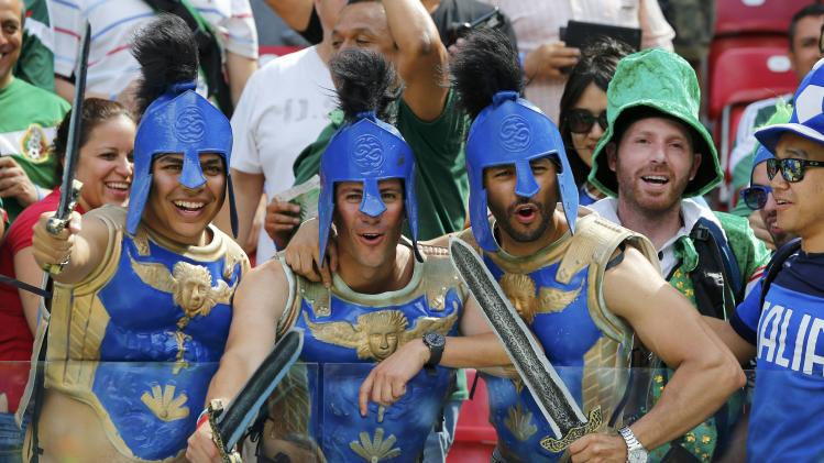 Italy fans pose before the 2014 World Cup Group D soccer match between Italy and Costa Rica at the Pernambuco arena