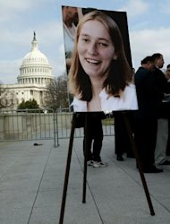 A picture of Rachel Corrie is diplayed with the US Capitol in the background during a press conference held by her parents in 2003 on Capitol Hill in Washington, DC, shortly after her death