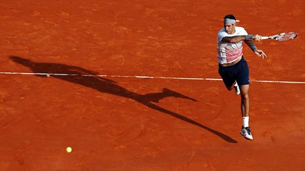 Juan Martin Del Potro of Argentina returns the ball to Alexandr Dolgopolov of Ukraine during the second round of the Monte Carlo Masters in Monaco (Reuters)