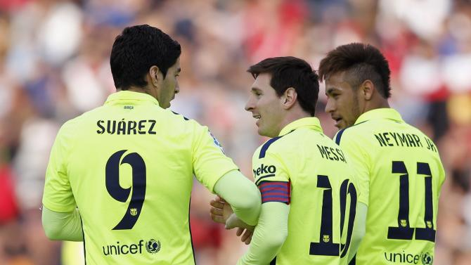 Barcelona's Messi is congratulated by teammates Suarez and Neymar after scoring a goal against Granada during their Spanish first division soccer match in Granada
