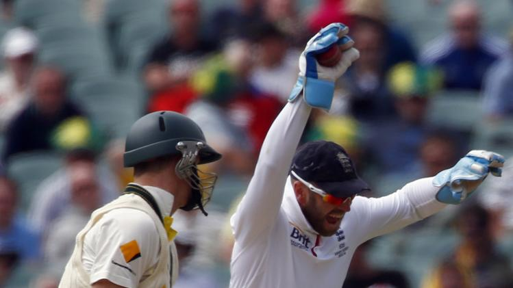 England's wicketkeeper Prior celebrates catching Australia's Smith for six runs during the first day's play in the second Ashes test in Adelaide